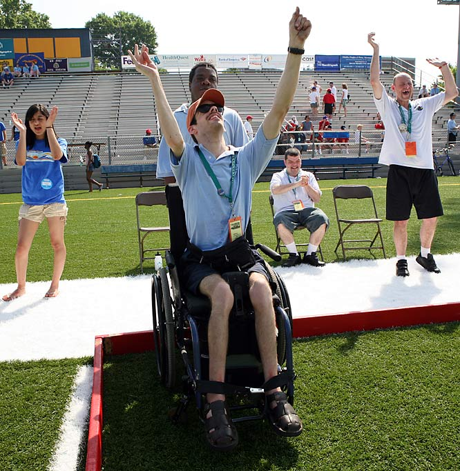 "Andy Reif, center, who has been a bocce player since 1996, celebrated a superb toss during the bocce competition in New Jersey. ""You've got to fight through the heat and everything, but it's worth it,"" says Reif, 25. ""I'm up here every year."""