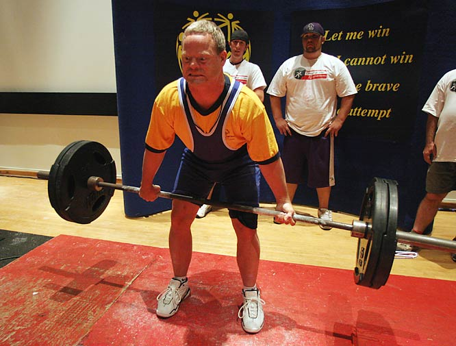 "Holmes, shown here during one of his deadlifts, is 41 and has been a powerlifter since 1989. ""He just loves to throttle back,"" says coach Rick Stolze. ""He's strong as an ox."""