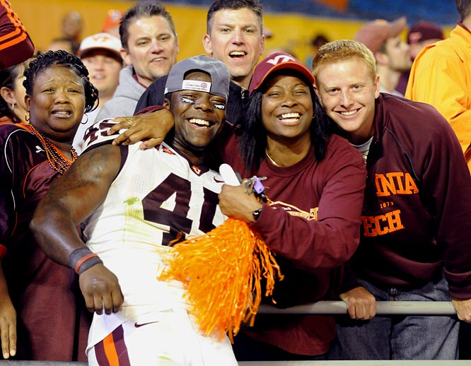A few lucky VaTech fans got to pose with Hokie linebacker Purnell Sturdivant after the team's Orange Bowl win.
