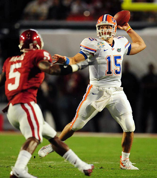 """For the second time in three years, Florida won a national title by shutting down a supposedly unstoppable offense. The young Gators defense held Oklahoma 40 points below its season average. After a rough first half in which he threw two interceptions, Tim Tebow carried Florida over the final 30 minutes, finishing with 231 yards passing and two touchdowns and 109 yards rushing. """"Tebow, just call him Superman,"""" Gators wideout Percy Harvin said. Harvin didn't have a bad game himself, running for 122 yards and a touchdown on nine carries and catching five passes for 49 yards. The Gators won the BCS title and finished atop the AP poll."""