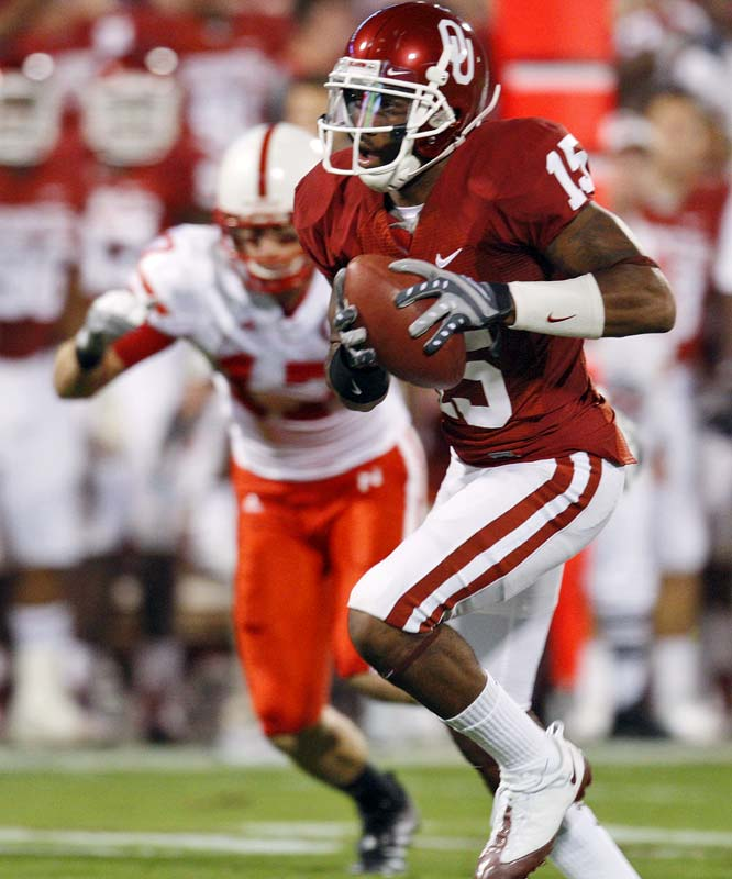Oklahoma CB Dominique Franks (left) picked off Joe Ganz's first pass attempt and returned it for an 18-yard touchdown as the Sooners jumped to a 28-0 lead in the first 5 1/2 minutes. Sam Bradford threw for 311 yards and five touchdown and the Sooners posted their highest point total ever in this storied rivalry.