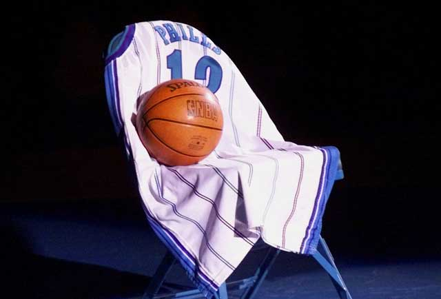 Charlotte Hornets guard Bobby Phills dies in an automobile accident near Charlotte Coliseum, following the team's shootaround.