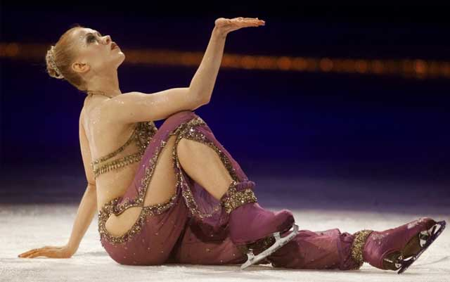 Ice skater Oksana Baiul is injured  when she crashes her car into a tree while driving in Connecticut.Tests reveal she was driving while intoxicated.