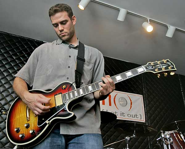 "After an 80-day departure, Theo Epstein (pictured here at the 2007 ""Hot Stove, Cool Music"" festival in Boston) returns to the Red Sox in a yet-to-be named capacity. The youngest general manager in baseball history, who assembled a World Champion team in 2004, had left Boston on Halloween Day, saying the position was not ""the right fit."""