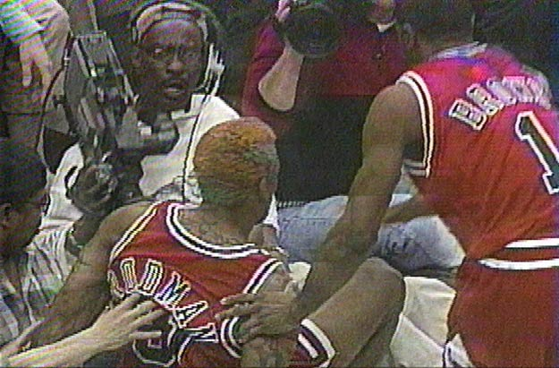Chicago's Dennis Rodman kicks cameraman Eugene Amosin in the groin. 'The Worm' would be suspended 11 games without  pay for the incident.