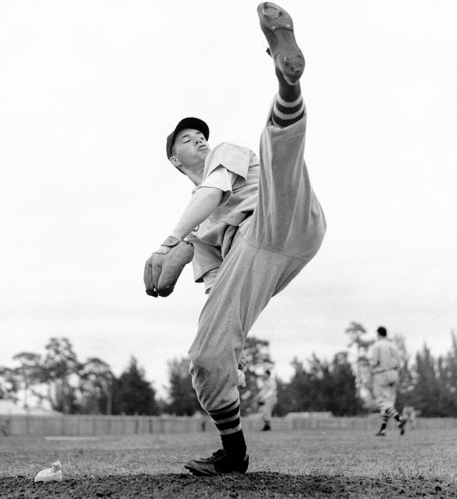 Known as one of the best pitchers of his era, Feller first appeared in a Indians uniform at the age of 19 and became the first pitcher to win at least 20 games in a season before the age of 21. Over his 18-year career, the Cleveland hurler won 266 games, threw three no-hitters and was named to eight All-Star teams.