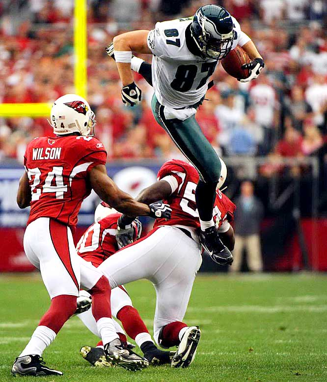 Tight end Brent Celek leaps over Cardinals' linebacker Gerald Hayes in the second quarter.