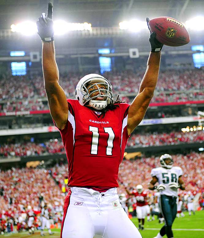 Larry Fitzgerald celebrates his third touchdown of the game and fifth of the playoffs.