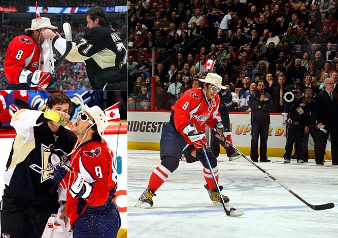 Evgeni Malkin helped last year's Breakaway Challenge champ Alex Ovechkin don a pair of sunglasses and a hat decorated with a Canadian flag before refreshing him with a squirt of Gatorade.  Ovechkin then borrowed Malkin's stick on his last shot in the event.
