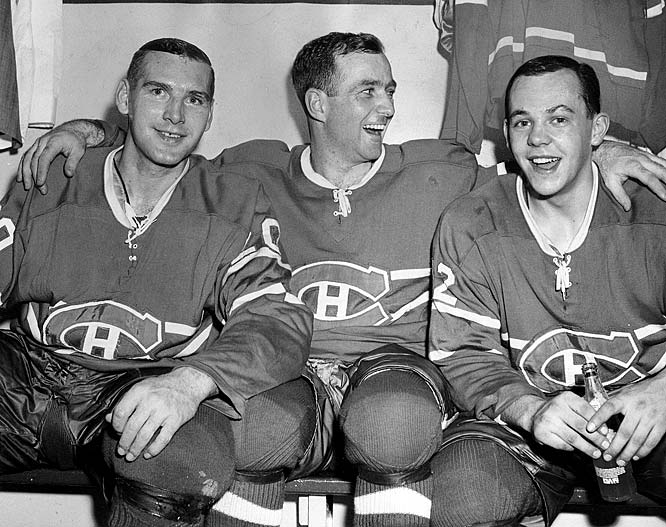 "(Left to right) Forwards Dave Balon, Dick Duff and Yvan ""Road Runner"" Cournoyer celebrated Lord Stanley's return to Montreal in 1965 after the Habs edged the Blackhawks in a seven-game final. The following season, the trio would enjoy a repeat after Henri Richard scored in overtime of Game 6 against Detroit."