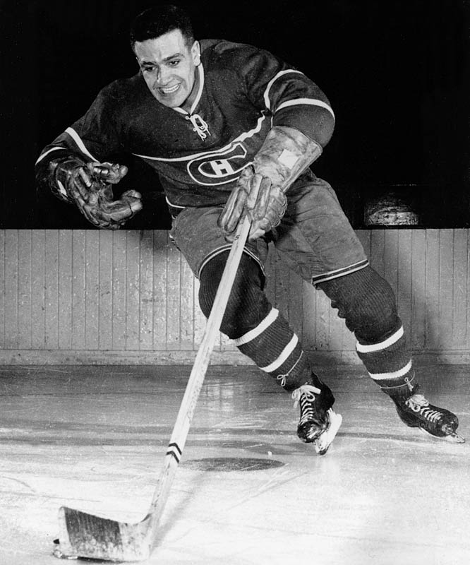 """Nicknamed """"Boom Boom"""" for his powerful slapper, Geoffrion was a colorful member of six Cup-winners. He was rookie of the year for 1951-52 and went on to win the Hart (1961) and two scoring titles. In 1960-61, he became only the second player in NHL history, after Montreal legend Rocket Richard, to score 50-goals in a season."""