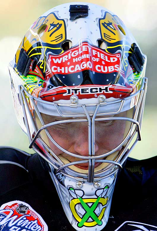 Blackhawks netminder Cristobal Huet wears a Wrigley Field painted goalie mask for the Winter Classic.