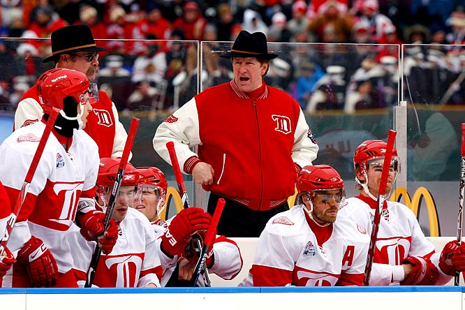 Red Wings head coach Mike Babcock stands behind the bench while dressed the vintage part.
