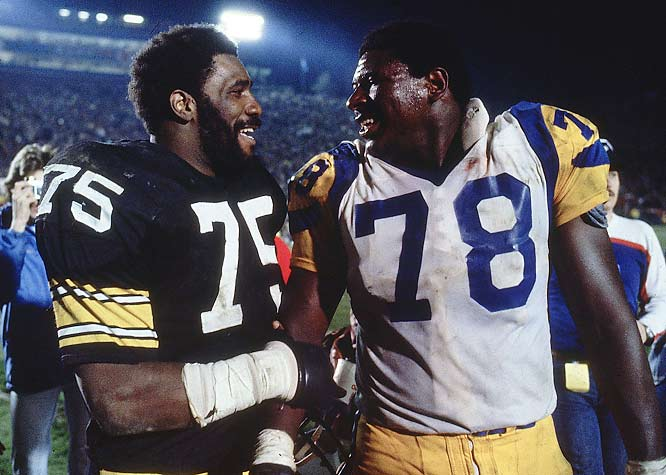 """Mean"" Joe Greene (75) and Jackie Slater (78) exchanged pleasantries after the game."