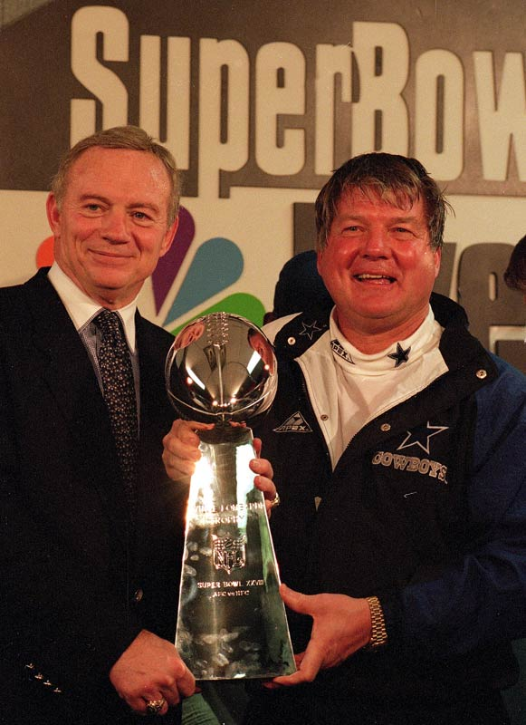 Dallas owner Jerry Jones and coach Jimmy Johnson pose in locker room with the Super Bowl trophy after defeating  Buffalo 30-13 in Super Bowl XXVIII.