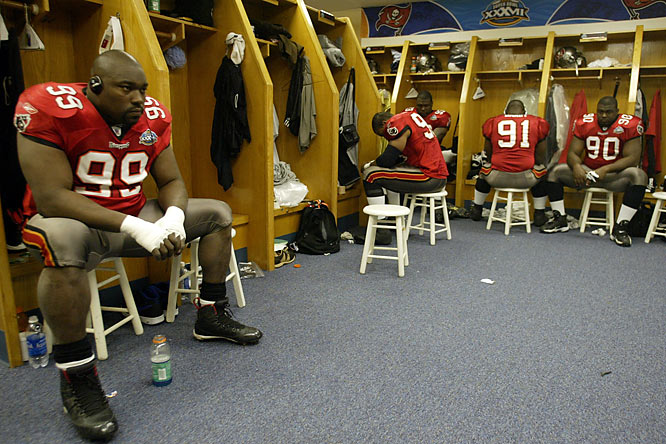 Tampa Bay Buccaneer defensive lineman Warren Sapp listens to music in the locker room prior to the start of Super Bowl XXXVII.