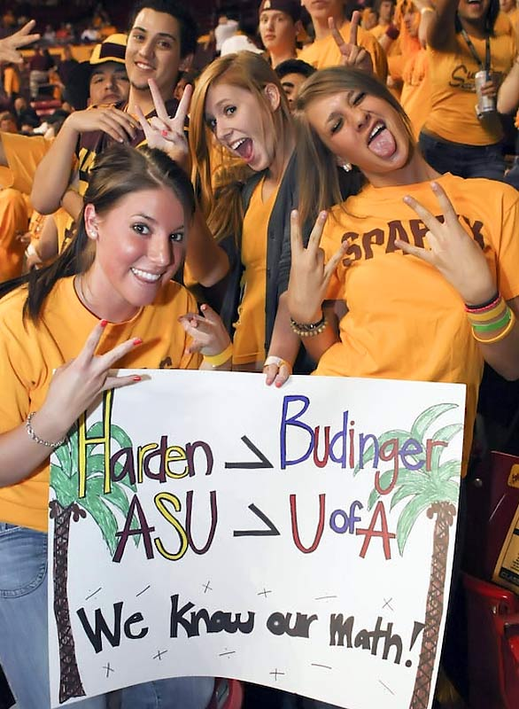 Arizona State Sun Devils fans make the team's pitchfork/trident hand gesture.