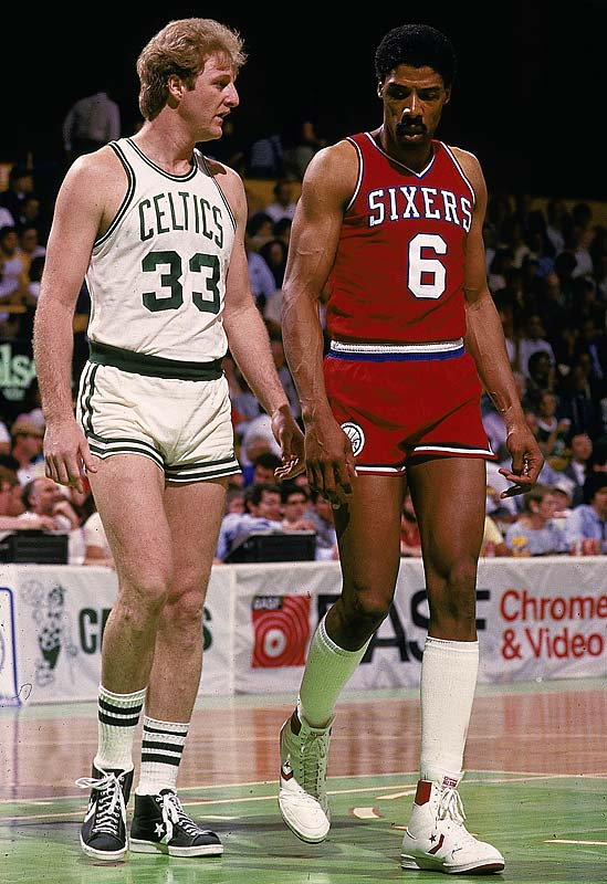 Larry Bird and Julius Erving exchange glares during a game at the Boston Garden.