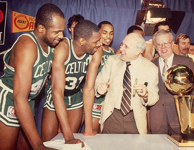Red Auerbach celebrates a championship with his trademark victory cigar.
