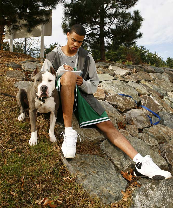 Former Celtic Gerald Green spends some quality time with his dog.