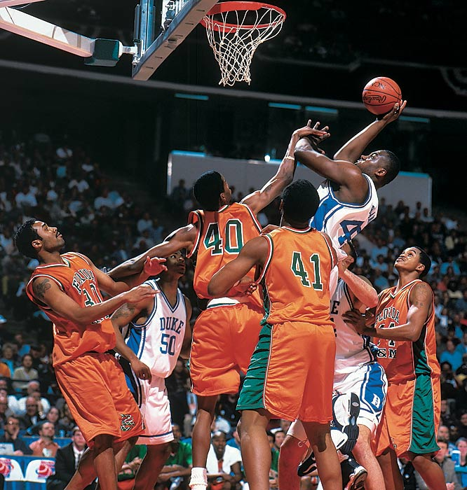 Elton Brand sneaks in a shot through a gaggle of Florida A&M defenders during the 1999 NCAA Tournament.