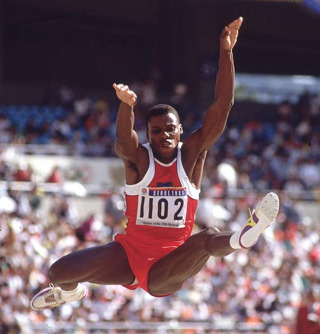 At Madison Square Garden in New York City, Carl Lewis breaks his own world record in the long jump by 9-1/4 inches.
