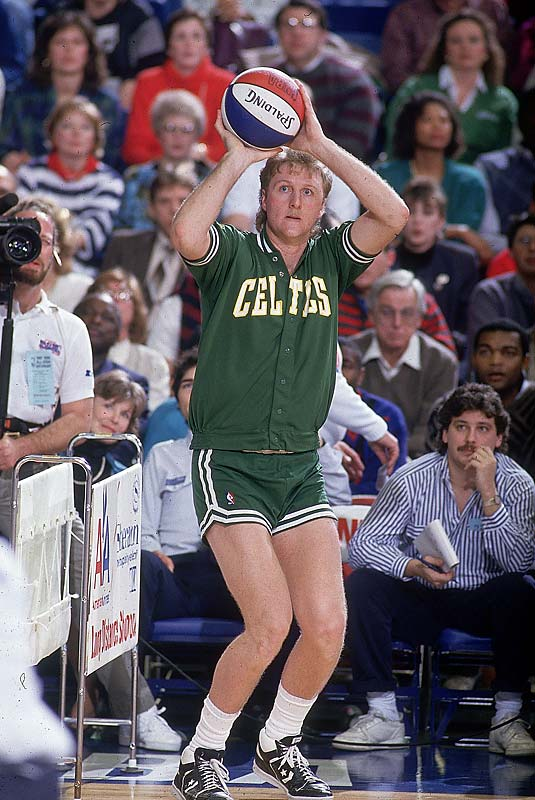 Larry Bird wins the Three-Point Contest on his final shot, extending his index finger to make a No. 1 sign as the ball swished through the net.