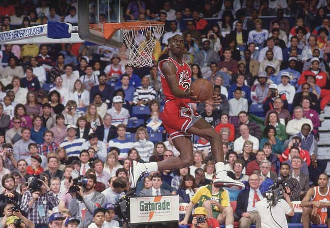 In Chicago, the Bulls' Michael Jordan wins the Slam Dunk Contest with a perfect score of 50 on his final dunk.