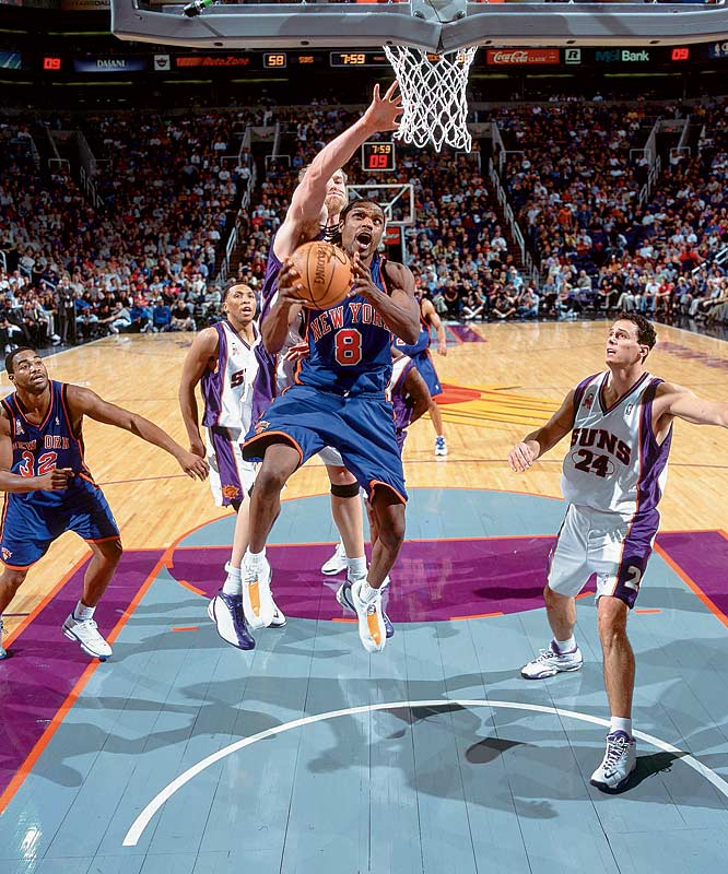 Latrell Sprewell searches for an opening during a game against the Suns.