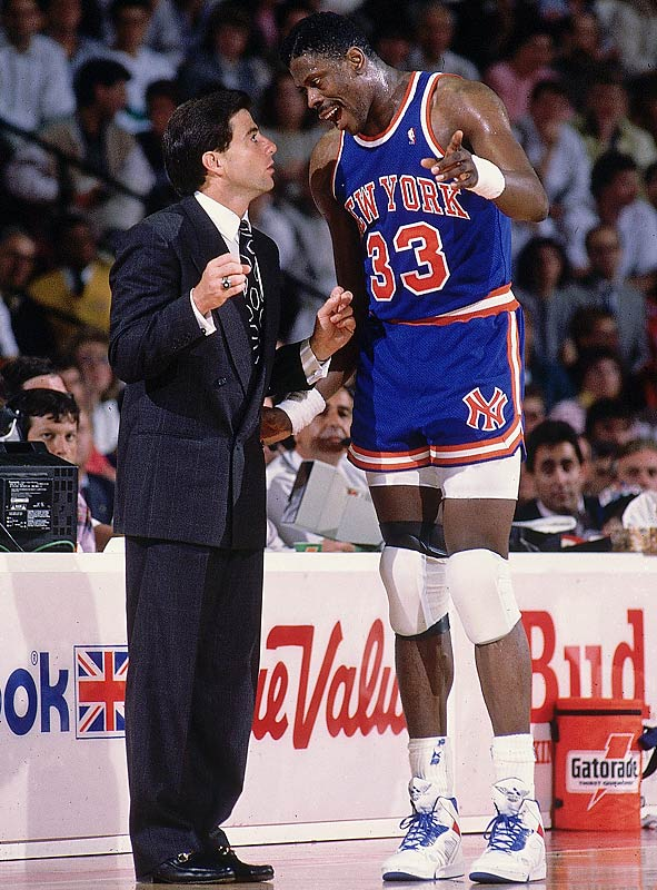 Rick Pitino gives some instructions to Patrick Ewing during a game against the Bulls.