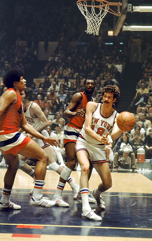 Phil Jackson passes out of traffic during a game against Baltimore.
