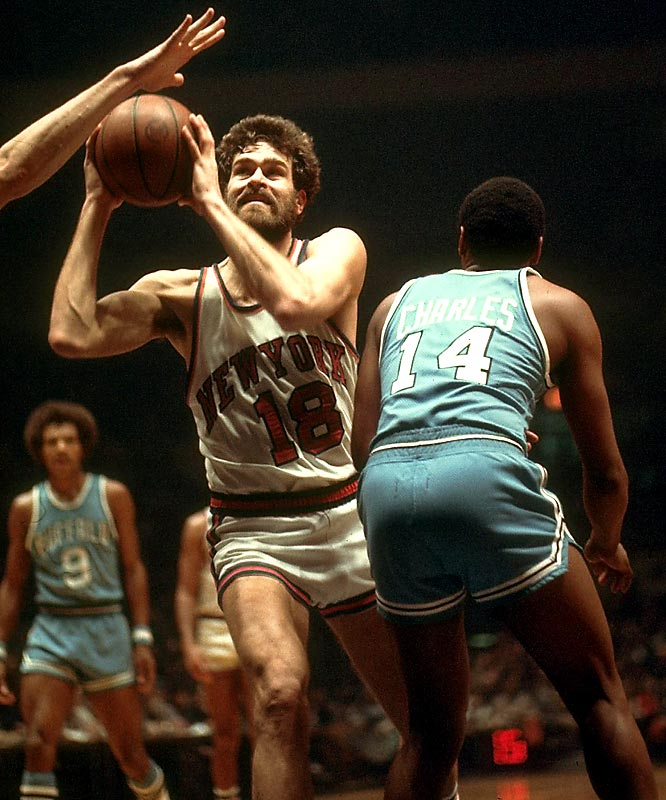 Phil Jackson drives past Buffalo's Kenny Charles and heads toward the basket.