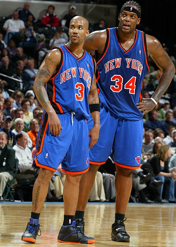 Stephon Marbury and Eddy Curry take in the action.