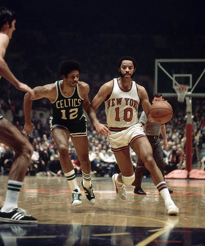 Walt Frazier sneaks past Boston's Don Chaney and glides to the rim.
