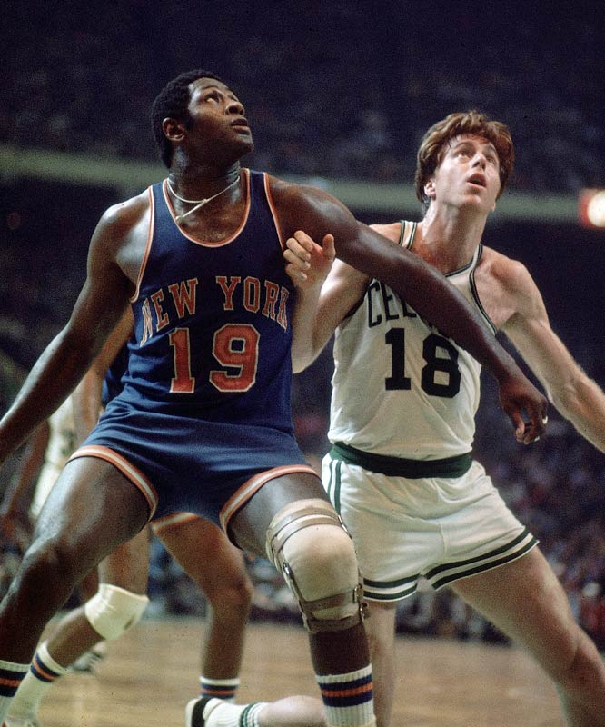 Willis Reed and Dave Cowens battle for a rebound.
