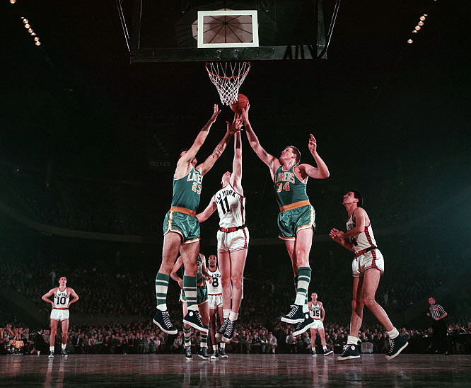 Ed Kalafat (No. 23) and Clyde Lovelette (No. 34) attempt to reject a shot taken by New York center Harry Gallatin (No. 11).