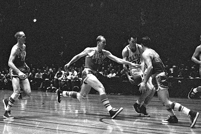 Boston's Ed Macauley (No. 22) glides past  Vern Mikkelsen (No. 19) during a Celtics-Lakers game.