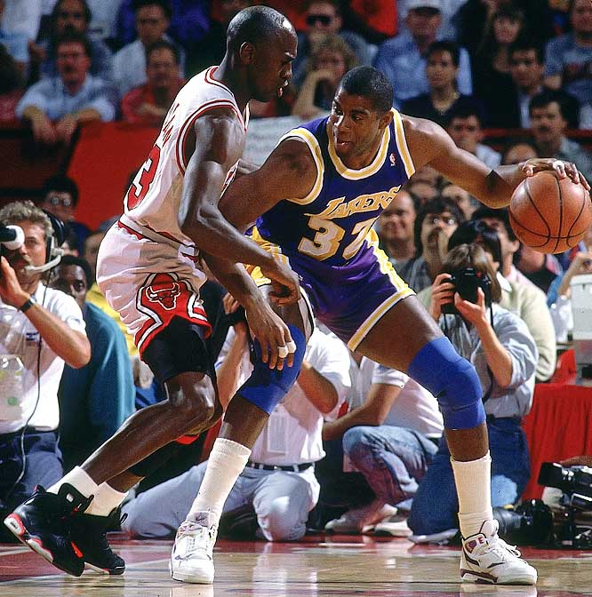 Magic Johnson posts up Michael Jordan during Game 2 of the NBA Finals.