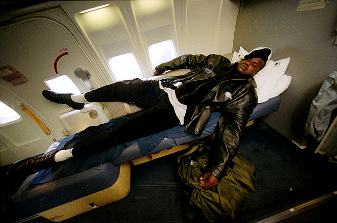 Shaquille O'Neal catches some sleep on the team's charter plane.