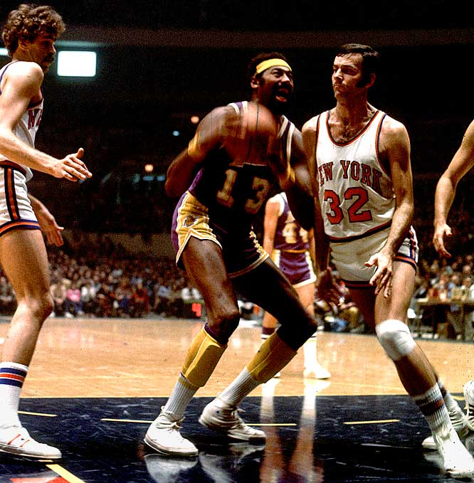 New York's Jerry Lucas (No. 32) leans on Wilt Chamberlain as the Lakers' center goes up for a dunk. To the left is former Knick and current Lakers coach Phil Jackson.