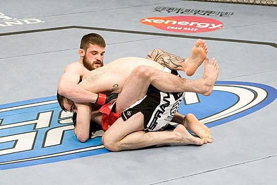 "A black belt in Brazilian Jiu-Jitsu, welterweight Dustin Hazelett (bottom) earned ""Submission of the Night"" honors in his win over Tamdan McCrory at UFC 91."