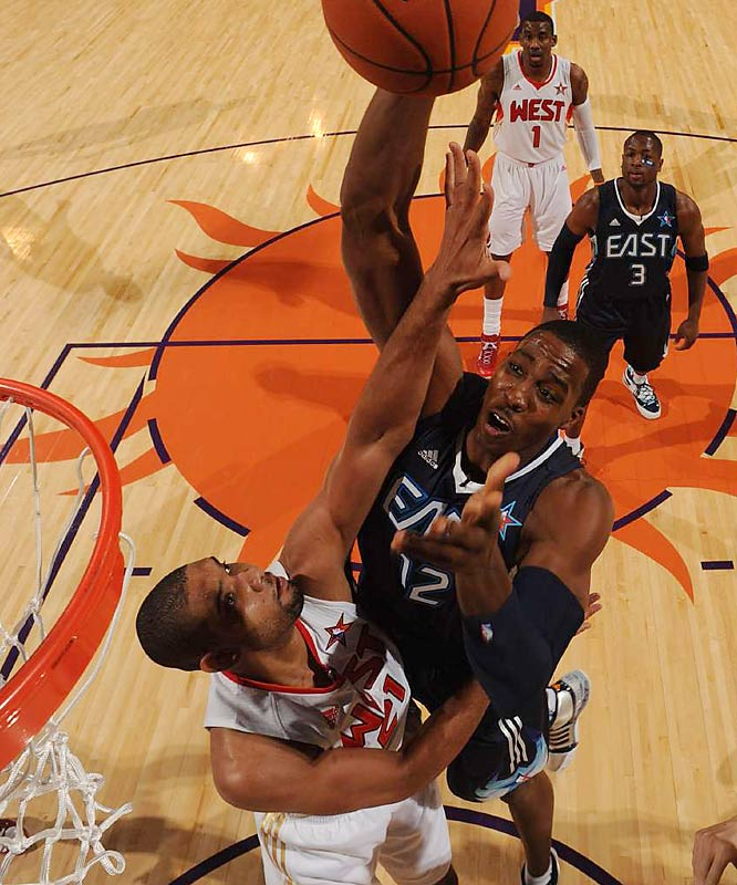 Dwight Howard didn't repeat as All-Star Weekend's Slam-Dunk champion, but he scored two of his 13 points around Yao Ming early in the first half.