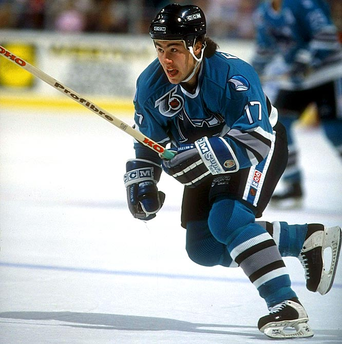 Drafted after Eric Lindros (right wing, Quebec Nordiques) in 1991 <br><br>Falloon's 59-point rookie season looked promising for the new franchise, but that was the winger's best campaign. During an injury-riddled sophomore season, he scored just 28 points in 41 games. He came back with 22 goals the next season, but uneven play became a pattern as he struggled to string together two productive seasons in a row. Before long, his name became a regular in the transactions column as he bounced from team to team, ultimately playing for five in his nine-year career.