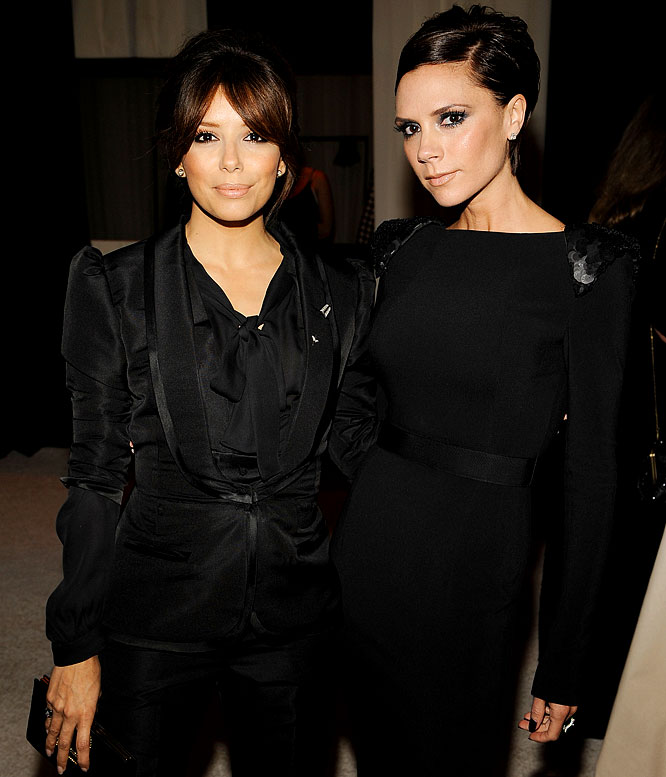 With David Beckham in Milan and Tony Parker in San Antonio, Victoria Beckham and Eva Longoria-Parker decided to keep each other company at Elton John's Oscar Party, walking down the white carpet together and chatting up Sir Elton when they arrived.
