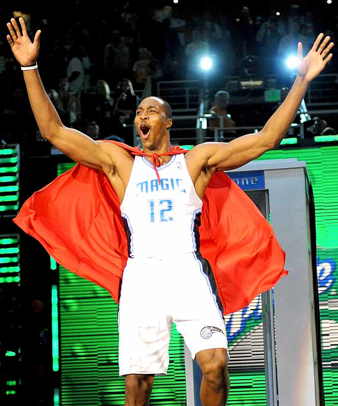 Reprising his Superman role from the '08 dunk contest, Dwight Howard comes out of a makeshift phone booth (that just happened to be in the arena) with cape in tow.