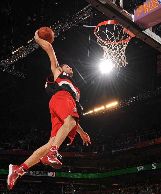 Blazers guard Rudy Fernandez goes solo on this spread-eagle dunk. He would use fellow Spaniard Pau Gasol in a subsequent slam.