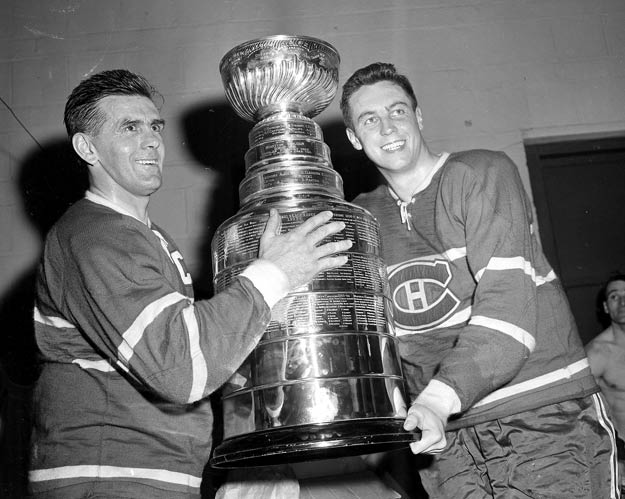 In a 6-2 victory over Minnesota, Montreal's Jean Beliveau (right, with Maurice Richard) scores his 500th career goal.