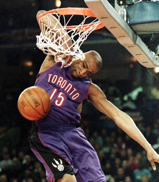 At NBA All-Star Saturday in Oakland, Vince Carter wows the crowd and edges out Steve Francis and Tracy McGrady to win the Slam Dunk Contest.