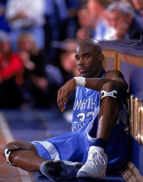 Antawn Jamison waits at the scorer's table, hoping to check in during a game against Duke.