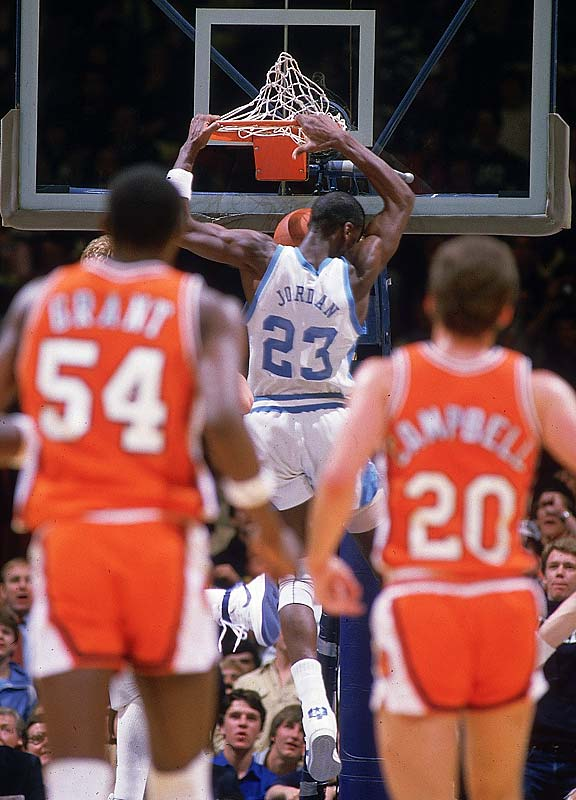 Michael Jordan shows off his athleticism during a game against Clemson. Also pictured is Horace Grant, who would go on to win three NBA championships with Jordan as a member of the Chicago Bulls.